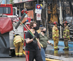 Read more about the article Volunteers rally to help secure and restore neighborhoods in wake of riot